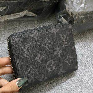 Black Monogram leather zippy coin wallet